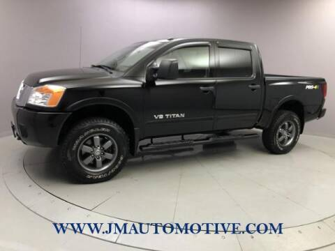 2014 Nissan Titan for sale at J & M Automotive in Naugatuck CT