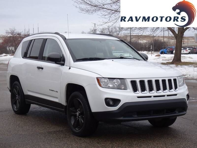 2016 Jeep Compass for sale at RAVMOTORS in Burnsville MN