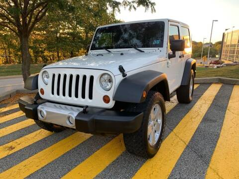 2009 Jeep Wrangler for sale at FAYAD AUTOMOTIVE GROUP in Pittsburgh PA
