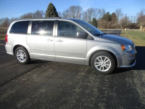 2014 Dodge Grand Caravan for sale at Crossroads Used Cars Inc. in Tremont IL