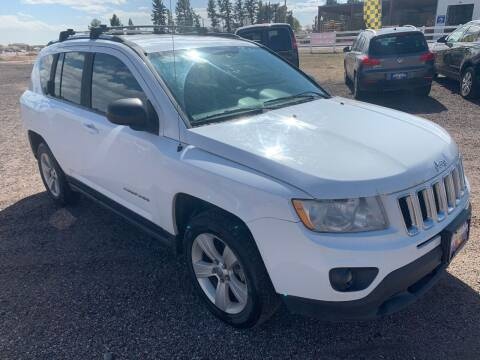 2012 Jeep Compass for sale at Praylea's Auto Sales in Peyton CO