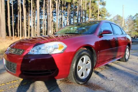 2009 Chevrolet Impala for sale at Oak City Motors in Garner NC