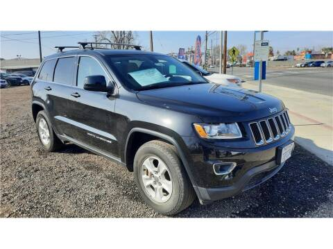 2015 Jeep Grand Cherokee for sale at Dealers Choice Inc in Farmersville CA