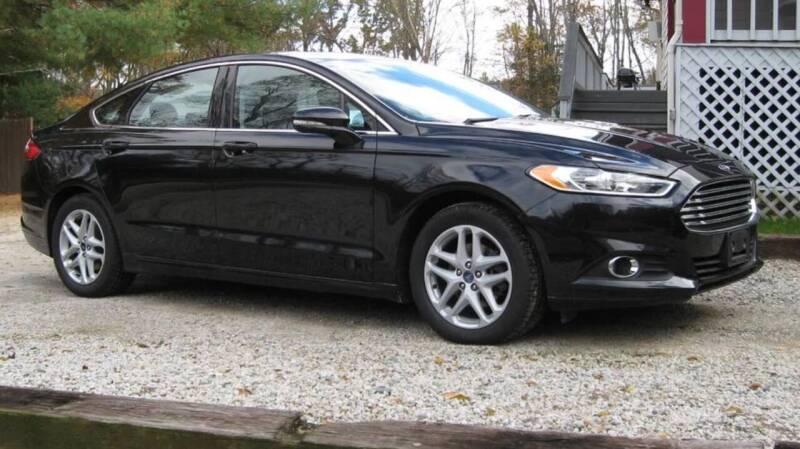 2014 Ford Fusion for sale at BORGES AUTO CENTER, INC. in Taunton MA