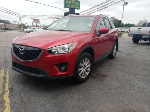 2014 Mazda CX-5 for sale at Pasadena Auto Planet in Houston TX