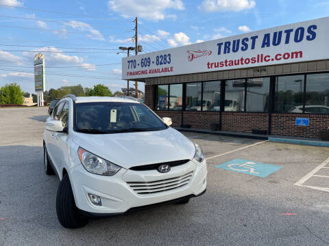 2013 Hyundai Tucson for sale at Trust Autos, LLC in Decatur GA