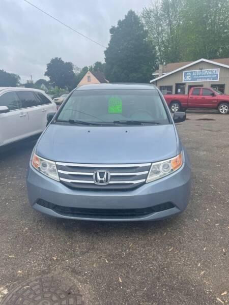 2012 Honda Odyssey for sale at Auto Consider Inc. in Grand Rapids MI
