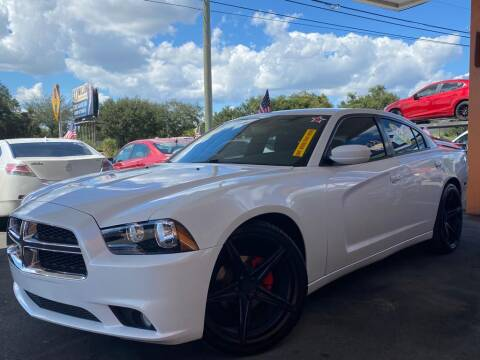 2013 Dodge Charger for sale at LATINOS MOTOR OF ORLANDO in Orlando FL