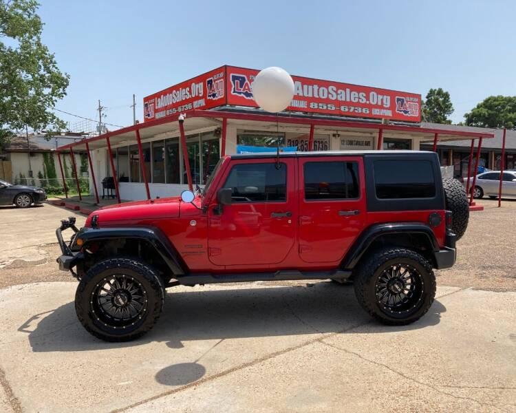 2014 Jeep Wrangler Unlimited for sale at LA Auto Sales in Monroe LA