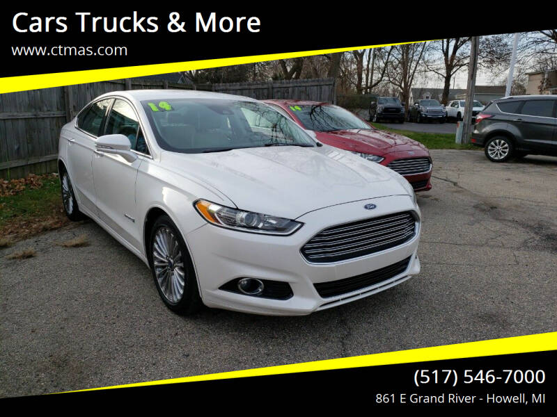2014 Ford Fusion Hybrid for sale at Cars Trucks & More in Howell MI