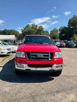 2004 Ford F-150 for sale at Autocom, LLC in Clayton NC