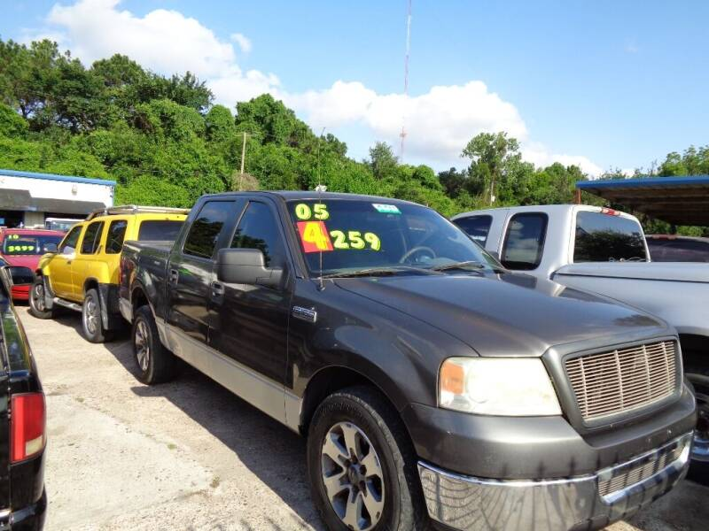 2006 Ford F-150 for sale at SCOTT HARRISON MOTOR CO in Houston TX
