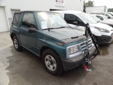 1997 GEO Tracker for sale at John's Auto Sales in Council Bluffs IA