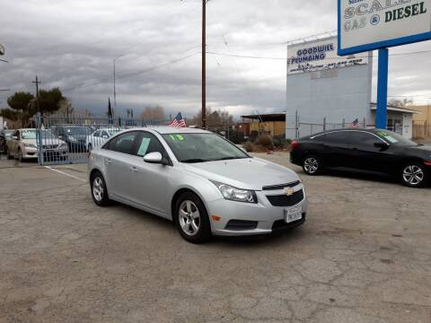 2013 Chevrolet Cruze for sale at Autosales Kingdom in Lancaster CA