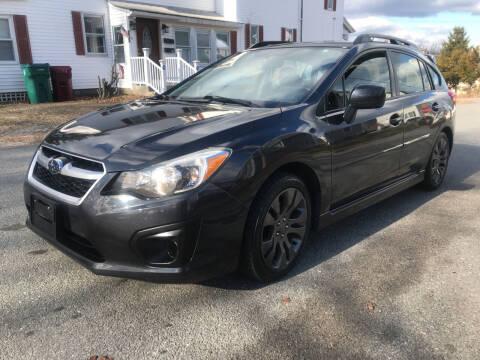 2012 Subaru Impreza for sale at D'Ambroise Auto Sales in Lowell MA