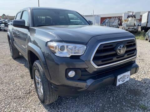 2019 Toyota Tacoma for sale at BERKENKOTTER MOTORS in Brighton CO