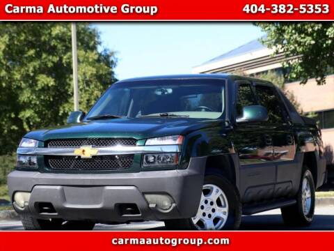 2004 Chevrolet Avalanche for sale at Carma Auto Group in Duluth GA
