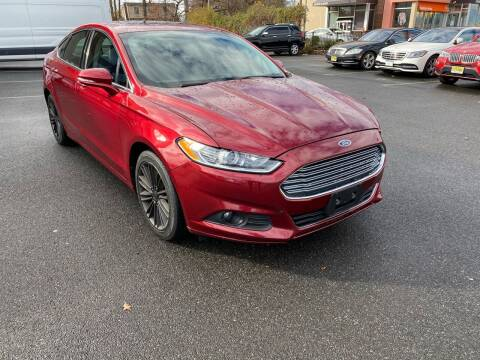2014 Ford Fusion for sale at MAGIC AUTO SALES in Little Ferry NJ