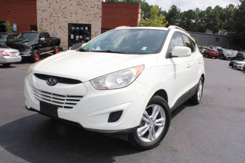 2011 Hyundai Tucson for sale at Atlanta Unique Auto Sales in Norcross GA