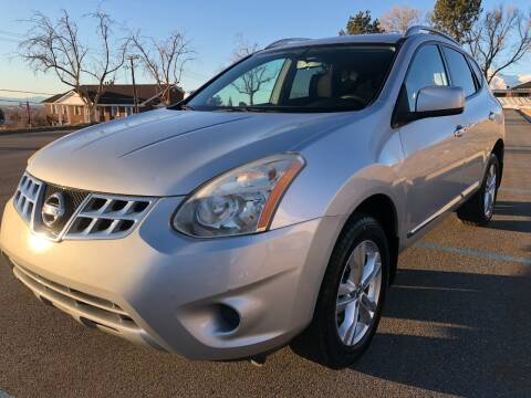 2012 Nissan Rogue for sale at DRIVE N BUY AUTO SALES in Ogden UT