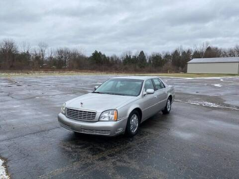 2004 Cadillac DeVille for sale at Caruzin Motors in Flint MI