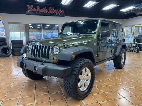 2009 Jeep Wrangler Unlimited for sale at The Auto Shoppe in Springfield MO