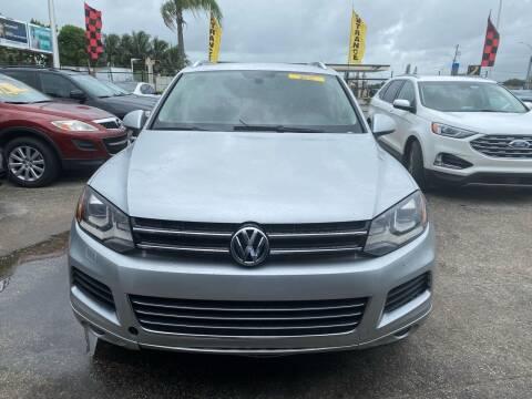 2014 Volkswagen Touareg for sale at America Auto Wholesale Inc in Miami FL