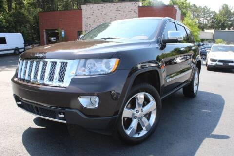 2012 Jeep Grand Cherokee for sale at Atlanta Unique Auto Sales in Norcross GA