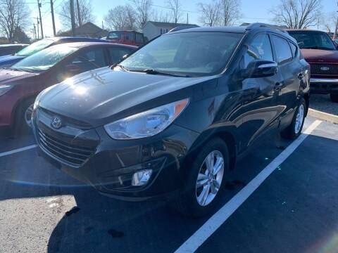 2013 Hyundai Tucson for sale at HILLS AUTO LLC in Henryville IN