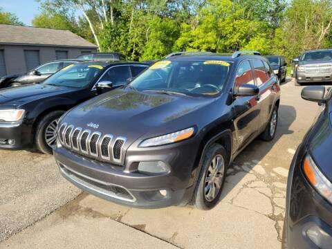 2014 Jeep Cherokee for sale at Clare Auto Sales, Inc. in Clare MI