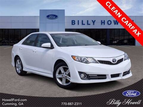 2014 Toyota Camry for sale at BILLY HOWELL FORD LINCOLN in Cumming GA