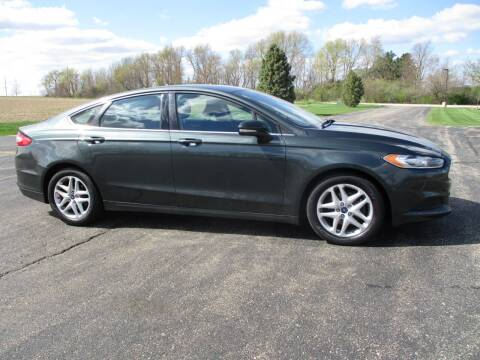 2015 Ford Fusion for sale at Crossroads Used Cars Inc. in Tremont IL
