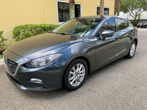 2014 Mazda MAZDA3 for sale at DENMARK AUTO BROKERS in Riviera Beach FL