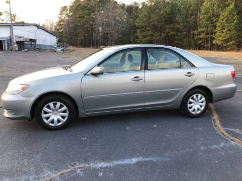 2006 Toyota Camry for sale at Global Autos in Kenly NC