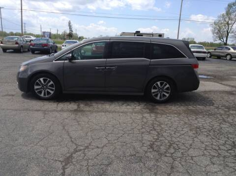 2014 Honda Odyssey for sale at Kevin's Motor Sales in Montpelier OH