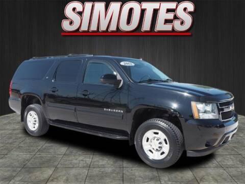 2012 Chevrolet Suburban for sale at SIMOTES MOTORS in Minooka IL