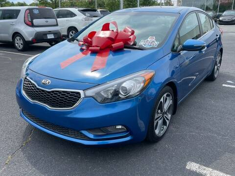 2015 Kia Forte for sale at Charlotte Auto Group, Inc in Monroe NC
