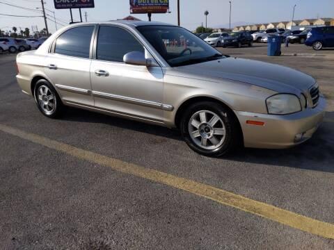 2006 Kia Optima for sale at Car Spot in Las Vegas NV