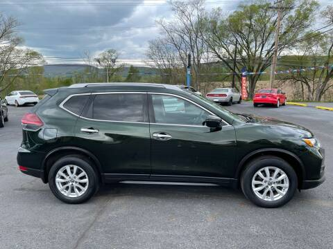 2018 Nissan Rogue for sale at MAGNUM MOTORS in Reedsville PA
