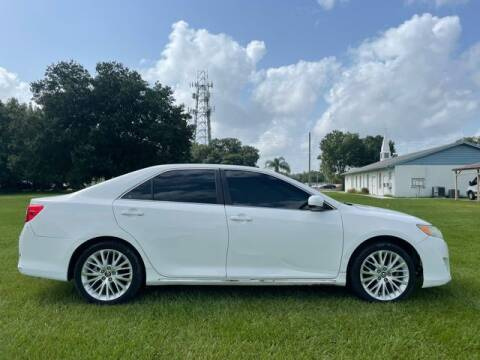 2012 Toyota Camry for sale at AM Auto Sales in Orlando FL