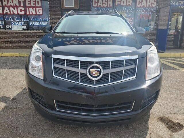 2012 Cadillac SRX for sale at R Tony Auto Sales in Clinton Township MI
