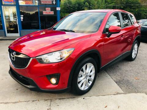 2015 Mazda CX-5 for sale at Capital Motors in Raleigh NC