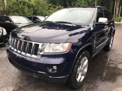 2013 Jeep Grand Cherokee for sale at Magic Motors Inc. in Snellville GA