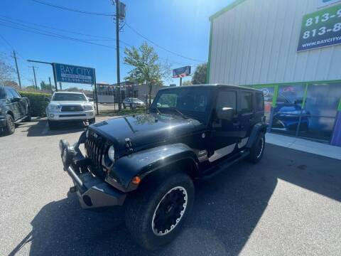 2011 Jeep Wrangler Unlimited for sale at Bay City Autosales in Tampa FL