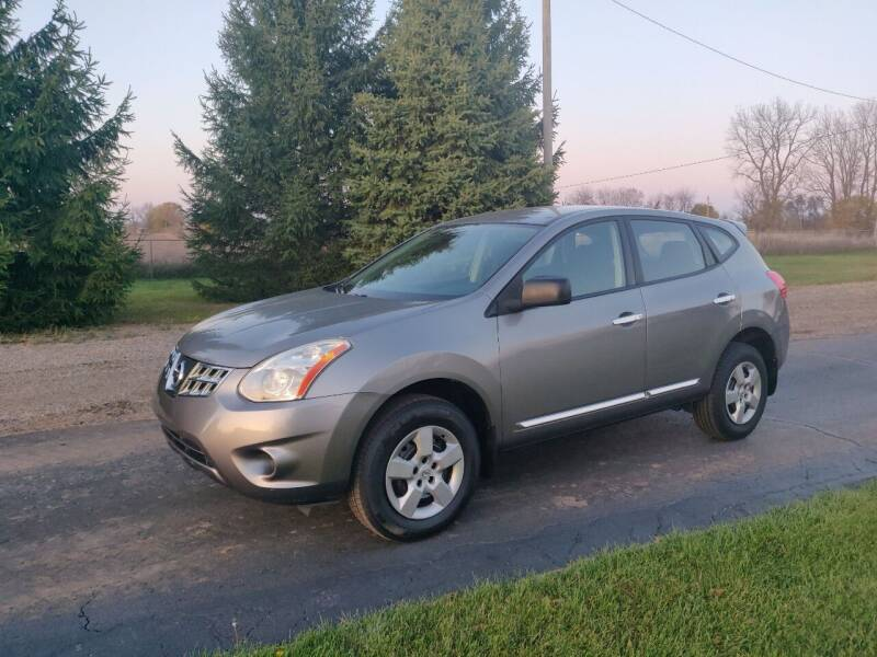 2011 Nissan Rogue for sale at Carmart Auto Sales Inc in Schoolcraft MI