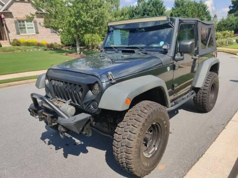 2010 Jeep Wrangler for sale at Gwinnett Luxury Motors in Buford GA