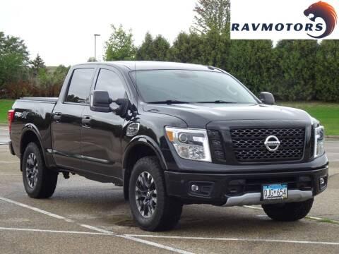 2018 Nissan Titan for sale at RAVMOTORS in Burnsville MN