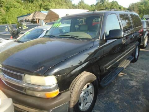 2004 Chevrolet Suburban for sale at SCOTT HARRISON MOTOR CO in Houston TX