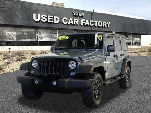2015 Jeep Wrangler Unlimited for sale at JOELSCARZ.COM in Flushing MI