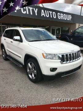 2012 Jeep Grand Cherokee for sale at Bay City Auto's in Mobile AL